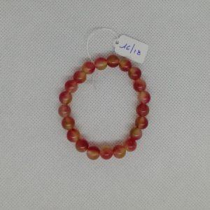 Bracelet composé d'un élastique doublé et agrémenté de perles Agate orange acidulé de 8 mm. Grade AAA. Tour de poignet de 16 à 18 cm.