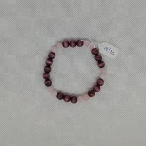 Bracelet composé d'un élastique doublé et agrémenté de perles Quartz Rose de 6 mm et Œil de chat Violet de 8 mm. Grade AAA. Tour de poignet de 18 à 20 cm.
