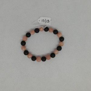 Bracelet composé d'un élastique doublé et agrémenté de perles Pierre de Lave et Pierre de Soleil de 8 mm. Grade AAA. Tour de poignet de 17 à 19 cm.